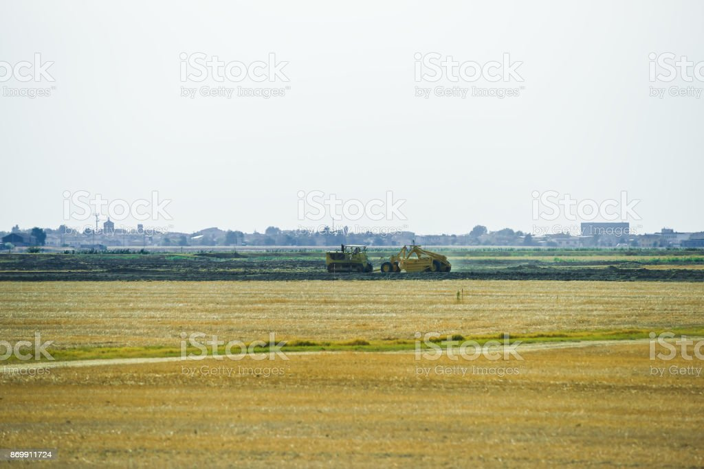 Tractor doing agricultural work in field of Austria summer stock photo