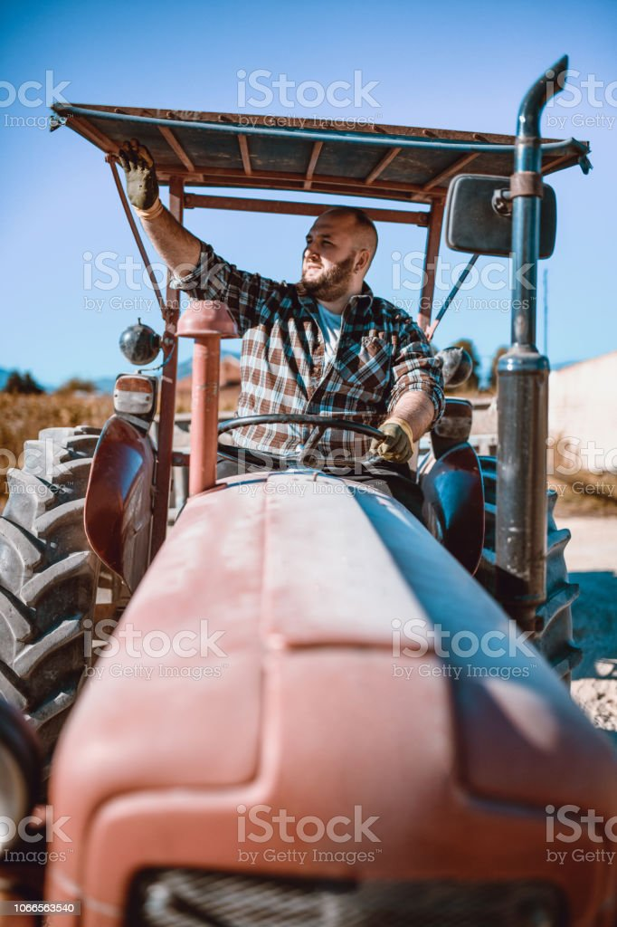 Tractor Driver Salutes His Colleagues stock photo