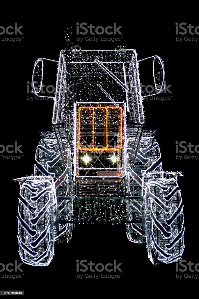 Tractor Garland lamp isolated on black. stock photo