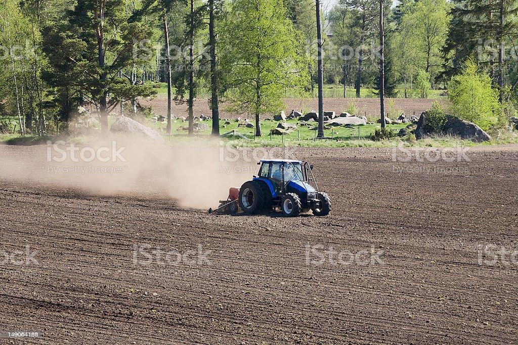 Tractor harrows royalty-free stock photo