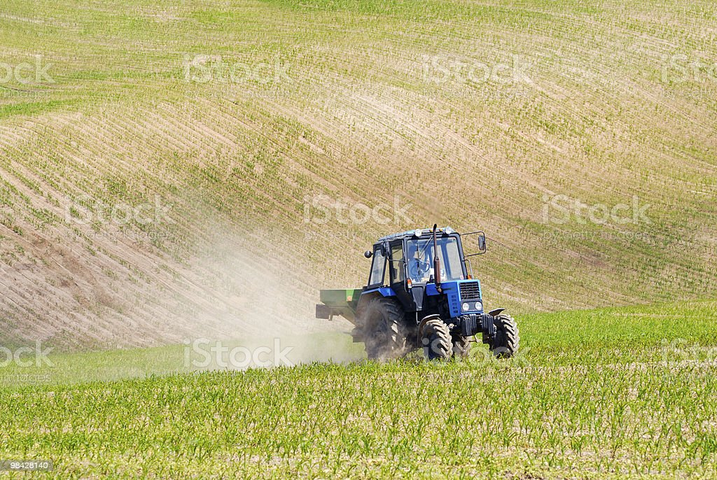 Tractor in a field early summer royalty-free stock photo