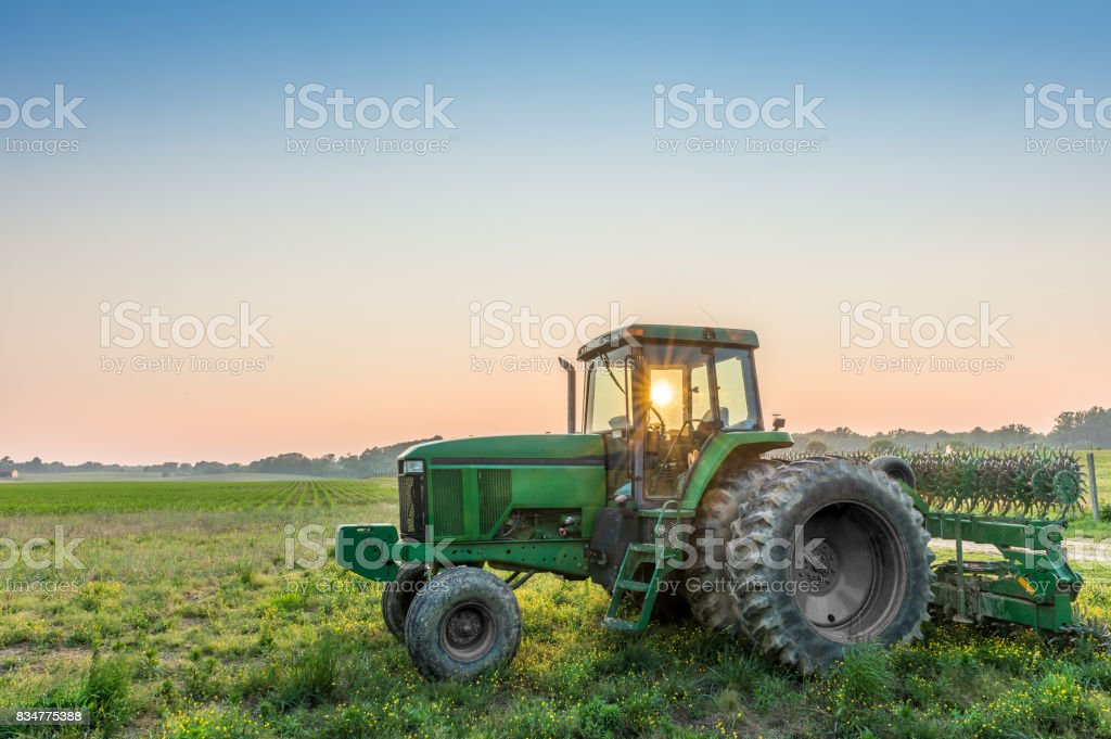 Tractor in a field on a rural Maryland farm stock photo