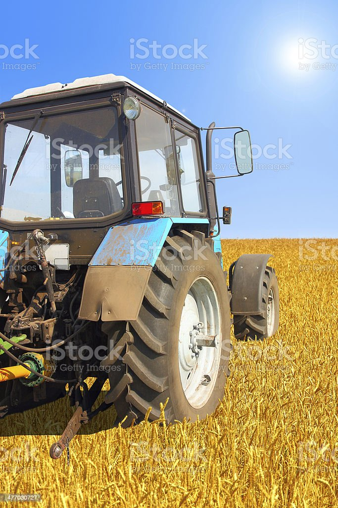 Tractor in a field, royalty-free stock photo