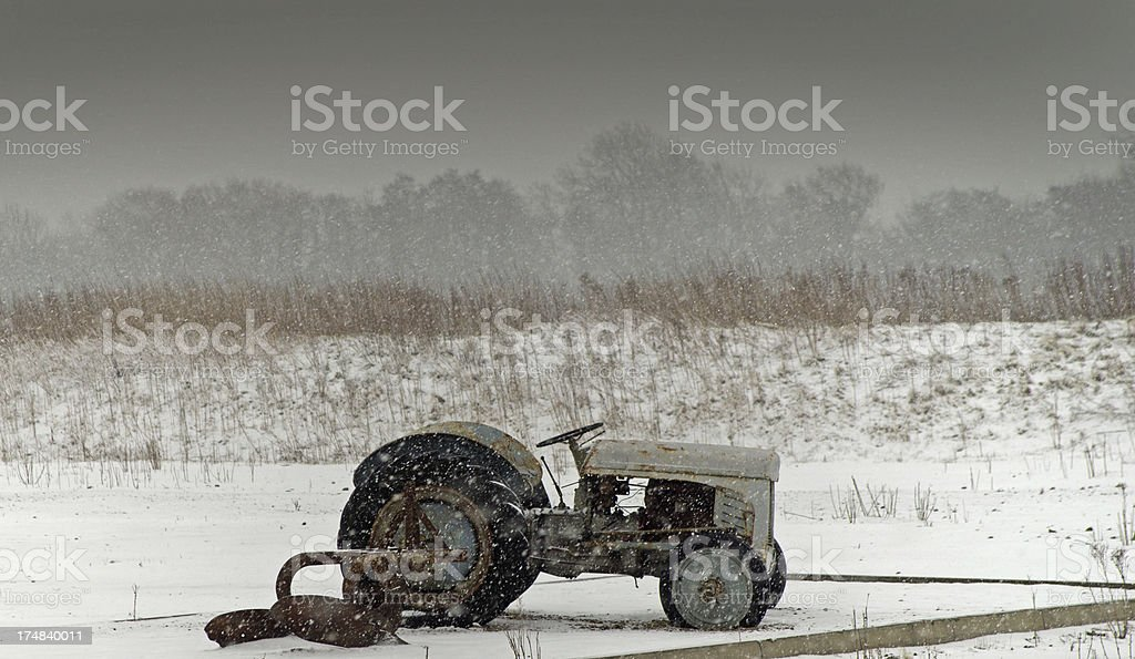 Tractor in a snowstorm royalty-free stock photo