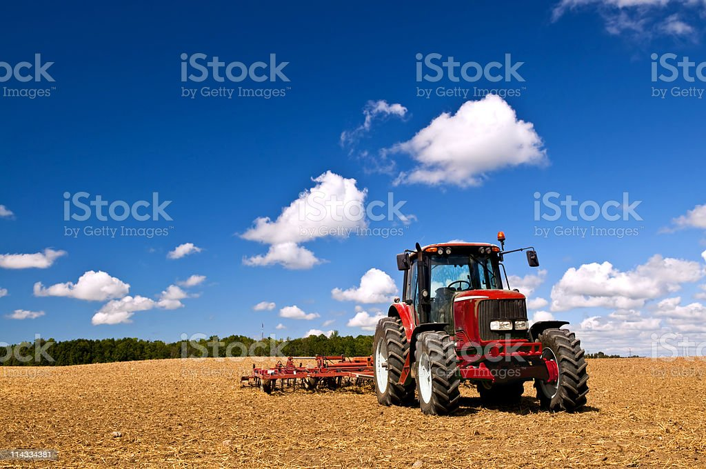 Tractor in plowed field stock photo