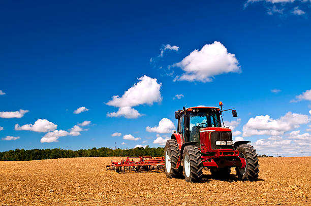 Tractor in plowed field stock photo