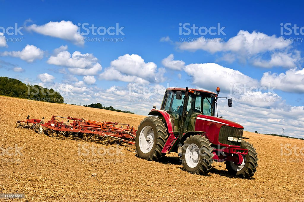 Tractor in plowed field royalty-free stock photo