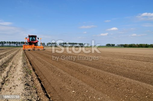 Tractor sowing the field in springtime.