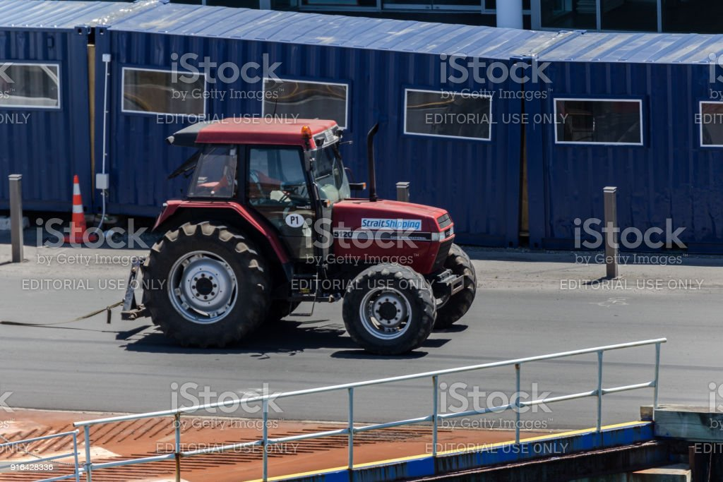 Tractor moving to Bluebridge ferry anchored in Wellington port, waiting for passengers, vehicles and freight to depart to Picton. stock photo