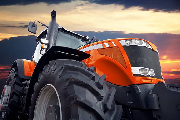 Tractor on a background cloudy sky stock photo