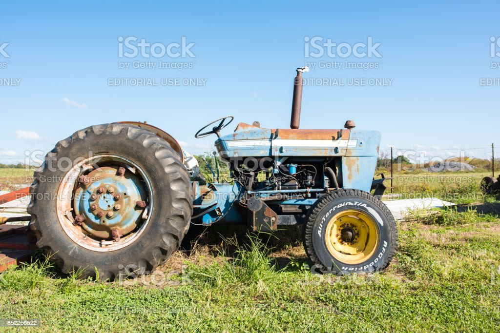 Tractor on a farm Chesnee, South Carolina, Sept. 10, 2017: A tractor, farm equipment, on a farm in upstate South Carolina. Agricultural Field Stock Photo