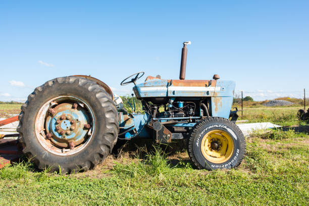 Tractor on a farm Chesnee, South Carolina, Sept. 10, 2017: A tractor, farm equipment, on a farm in upstate South Carolina. apostate stock pictures, royalty-free photos & images
