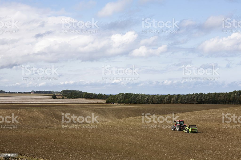 Tractor on a field royalty-free stock photo