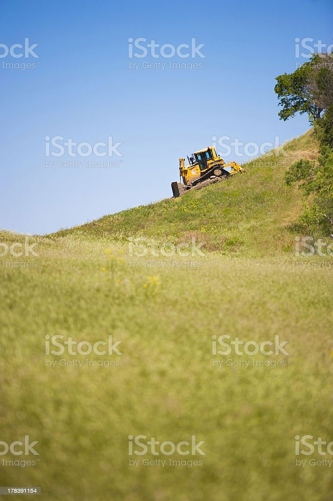 Tractor on a Hill against  blue sky royalty-free stock photo