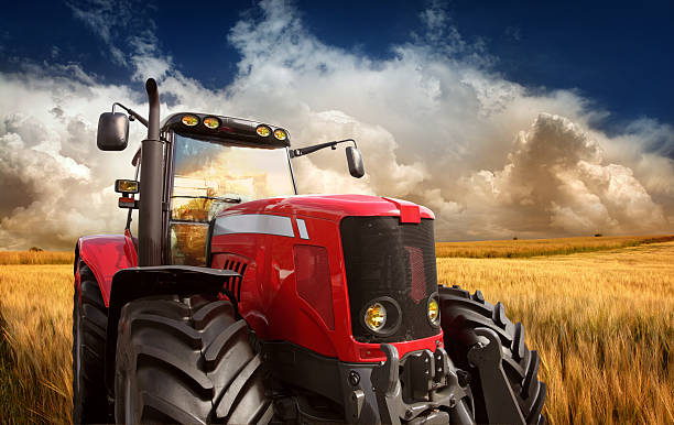 """Tractor on the Field New Modern Tractor on the Barley Field in Sunset Light, Photomontage. See more pictures from my lightbox """"On The Farm"""":  agricultural equipment stock pictures, royalty-free photos & images"""