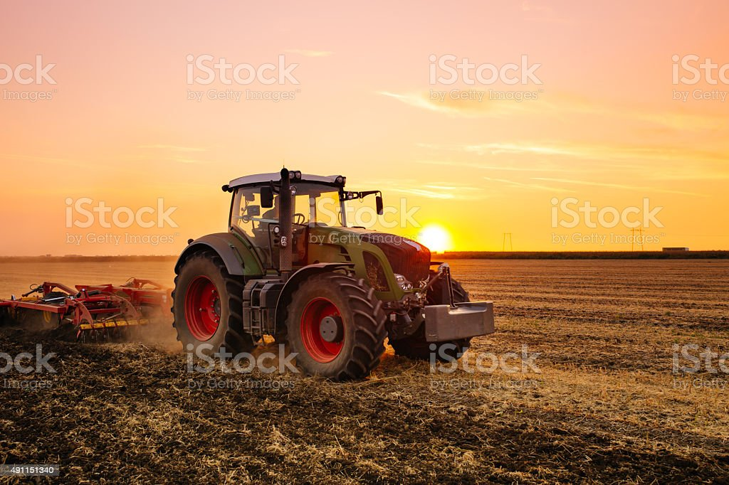 Tractor on the field stock photo