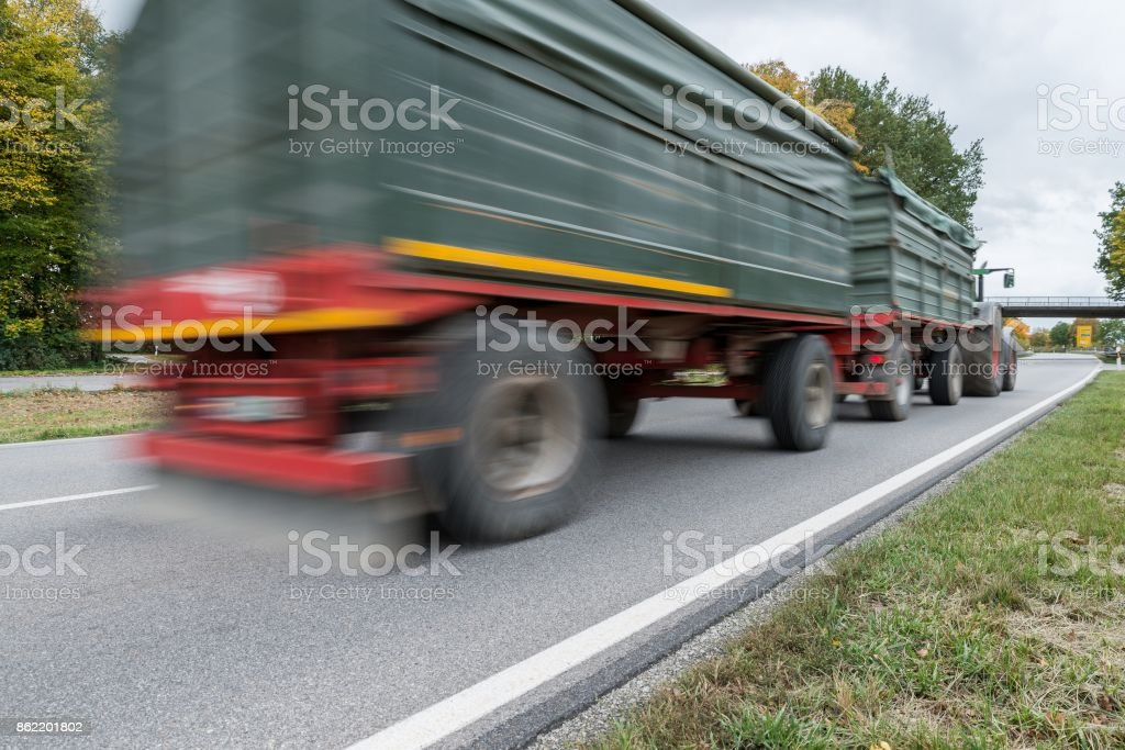 Tractor passing by on a national highway, Germany stock photo
