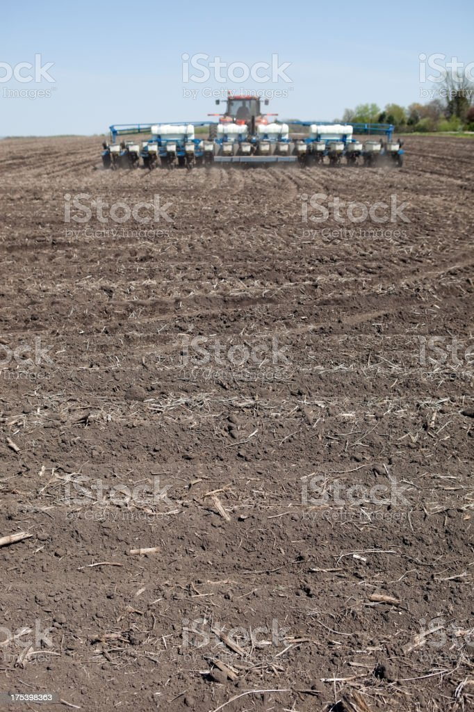 Tractor Planting Corn Seed in Field royalty-free stock photo