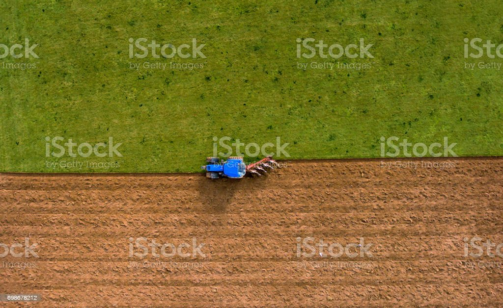 Tractor Ploughing Plowing Field - Aerial Shoot stock photo