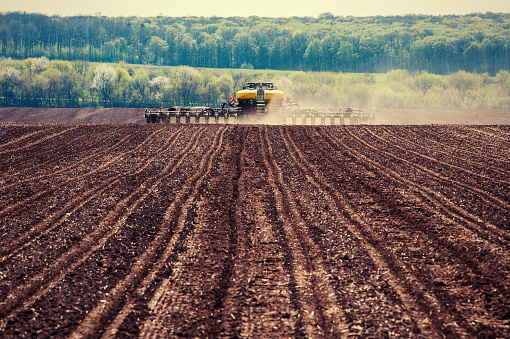 Tractor Plowing Farm Field In Preparation For Spring Planting Stock Photo - Download Image Now