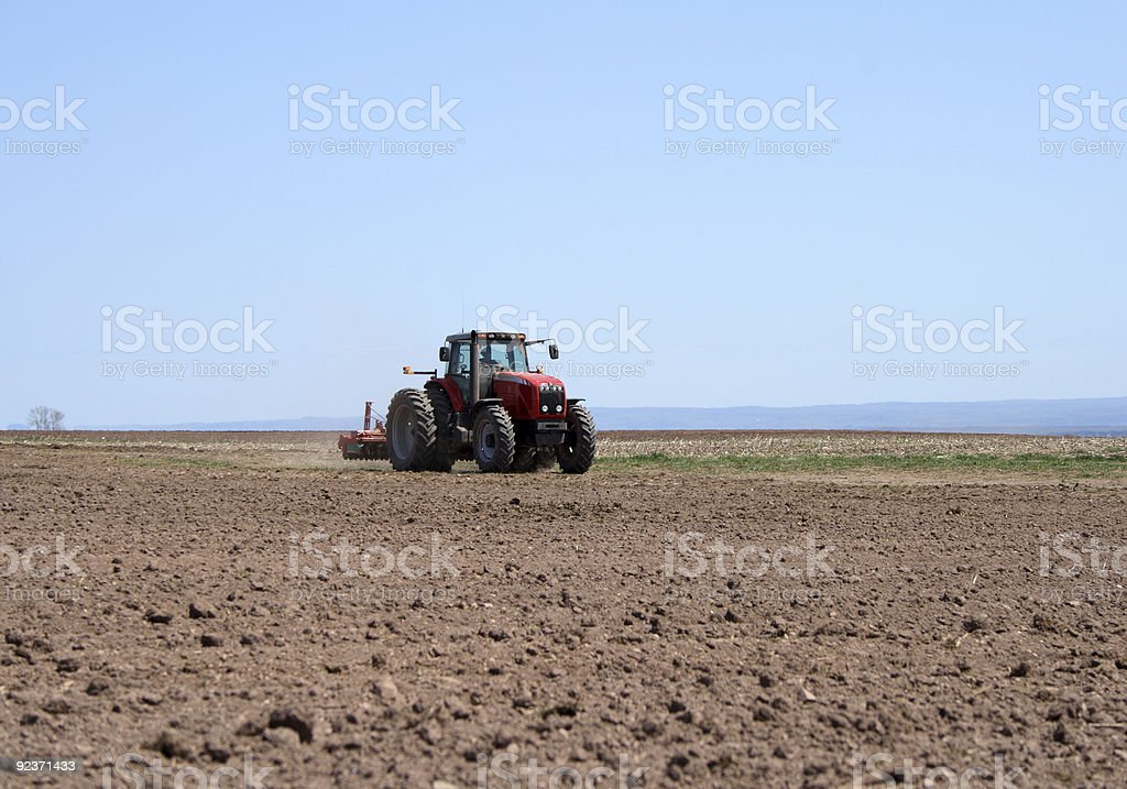 Tractor plowing land royalty-free stock photo