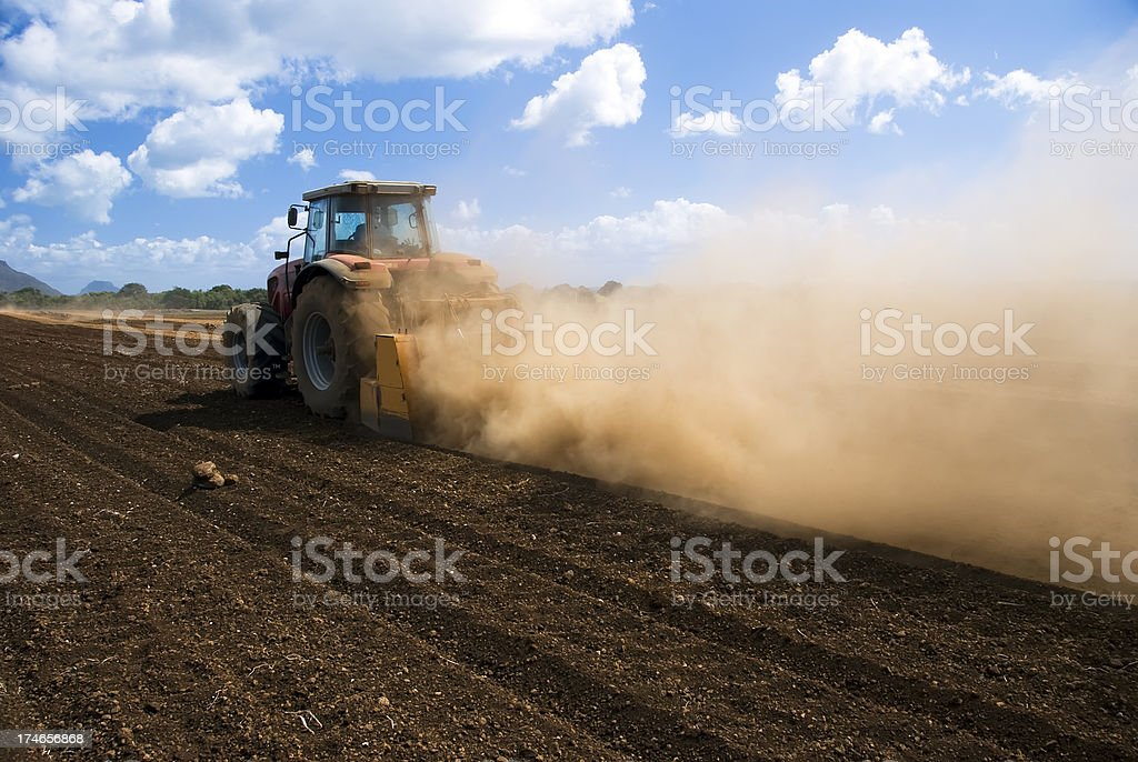 Tractor preparing a Field royalty-free stock photo