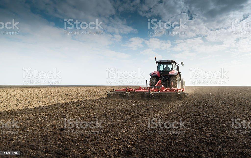 Tractor preparing land stock photo