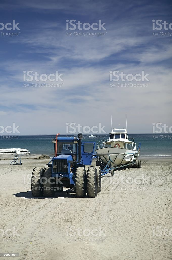 Tractor pulling whale watching ship royalty-free stock photo