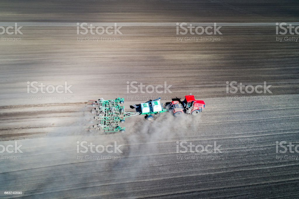 tractor sowing in the field 免版稅 stock photo