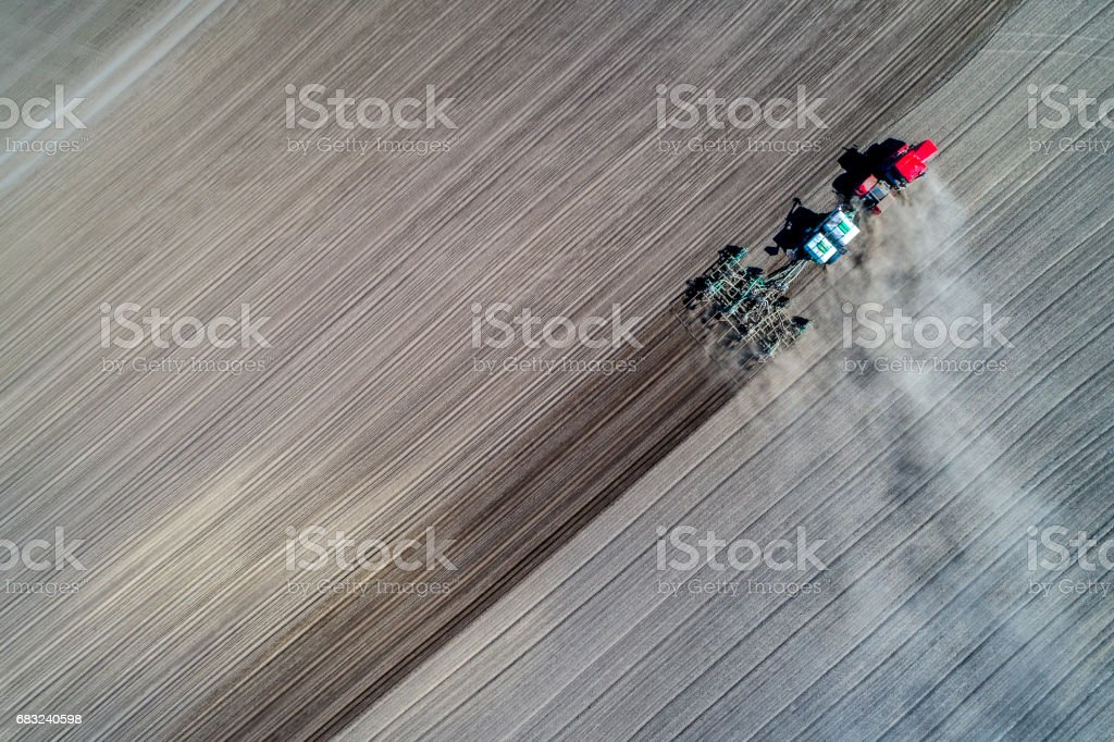 tractor sowing in the field royalty-free stock photo
