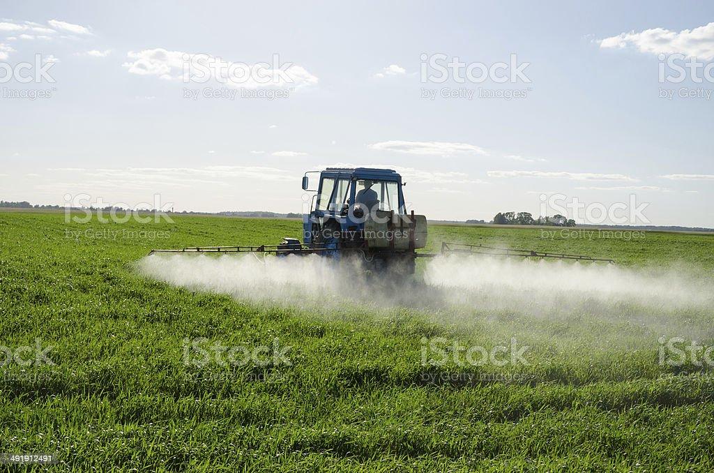Tractor spray fertilize field pesticide chemical stock photo