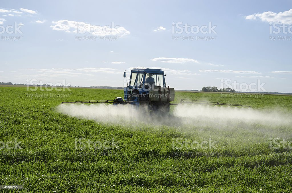 Tractor spray fertilize field pesticide chemical royalty-free stock photo