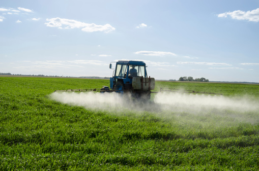 Tractor Spray Fertilize Field Pesticide Chemical Stock Photo - Download Image Now