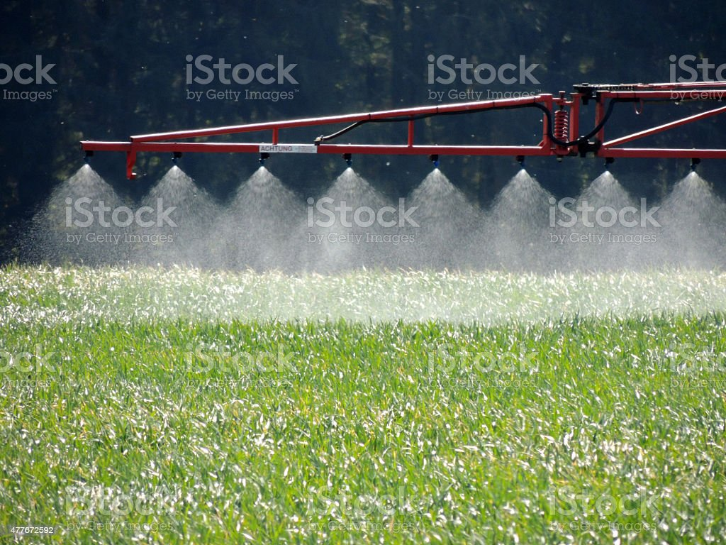 Tractor spraying a field stock photo