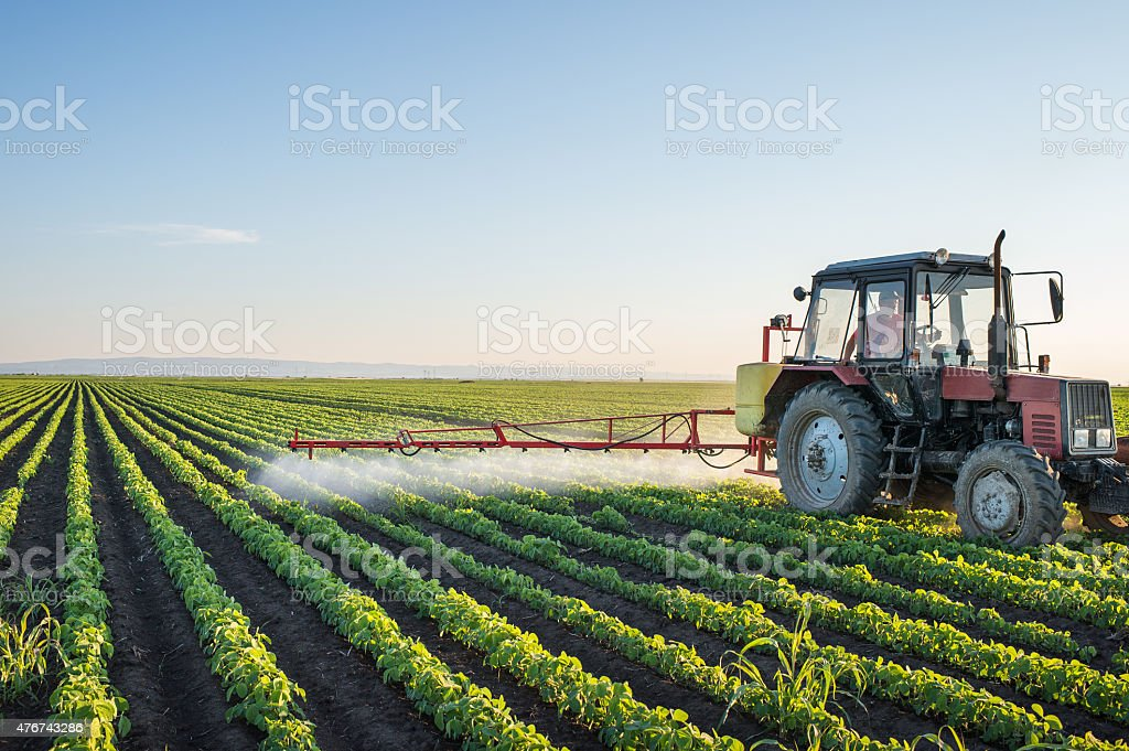 Tractor spraying stock photo