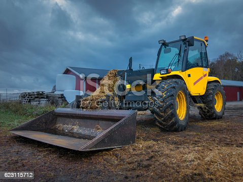 Tractor telescopic handler after worked with manure, dung