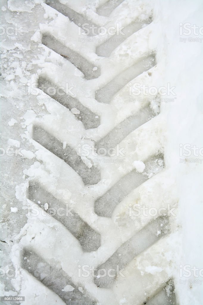 Tractor tracks in snow stock photo