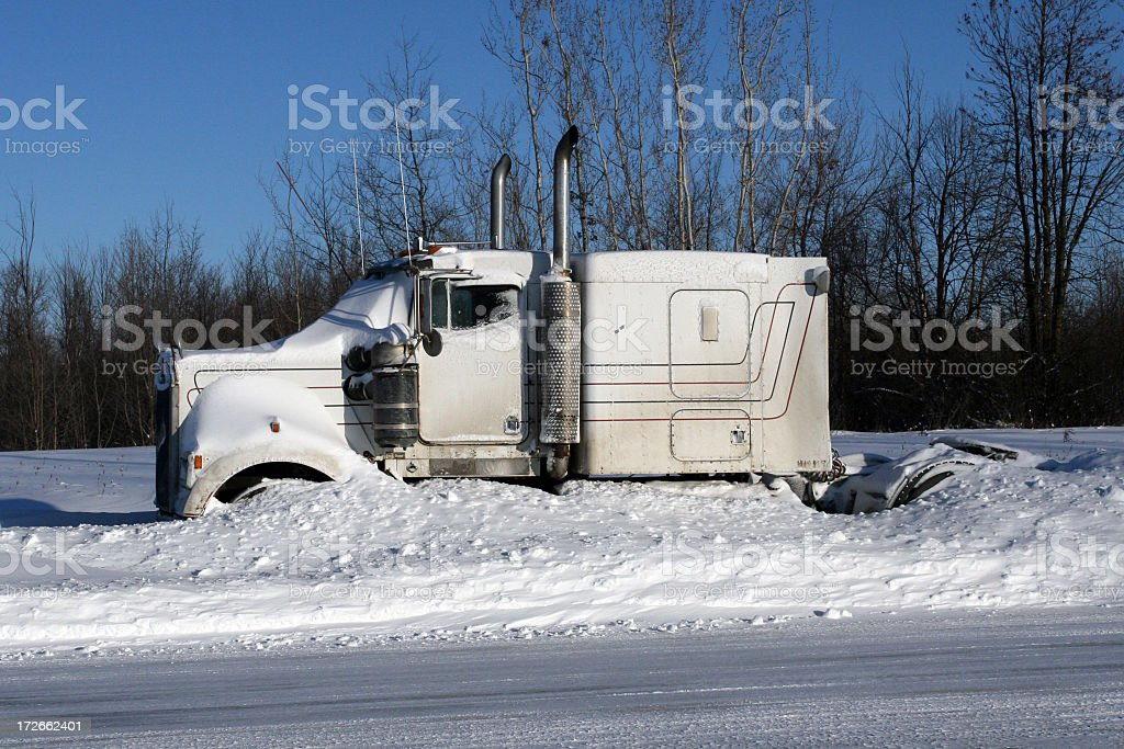 Tractor trailer stuck in snow after snowstorm royalty-free stock photo
