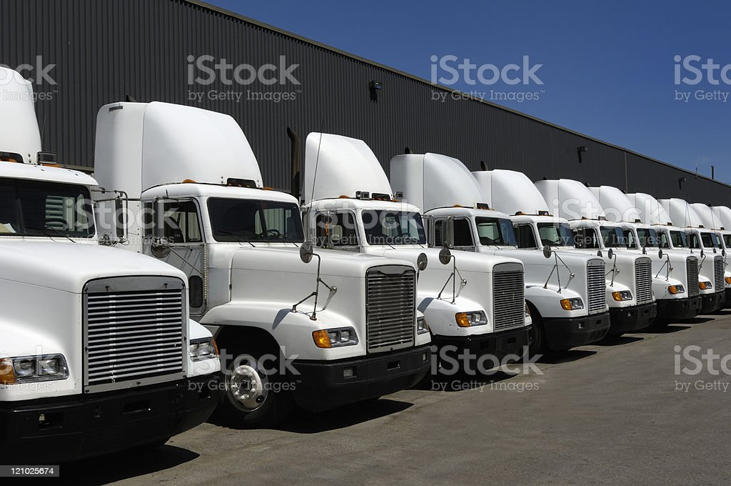Tractor trailers in line stock photo