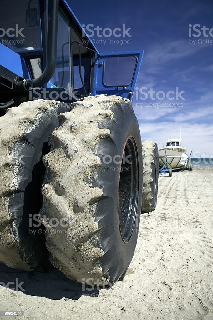 Tractor wheels with Whale Watching boat royalty-free stock photo