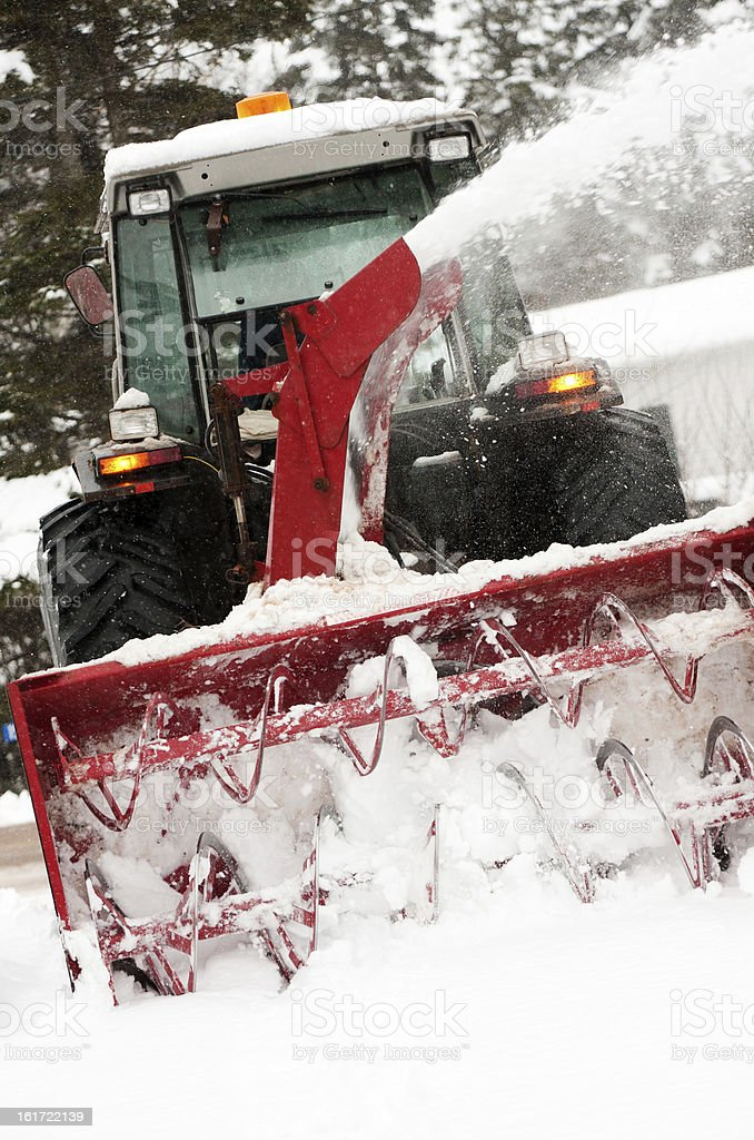 tractor with attachment clearing away snow stock photo