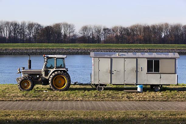 tractor with cabin on wheels - mülltonnenhäuschen stock-fotos und bilder