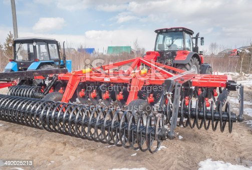 171320236 istock photo Tractor with hinged equipment. Tyumen. Russia 492025213
