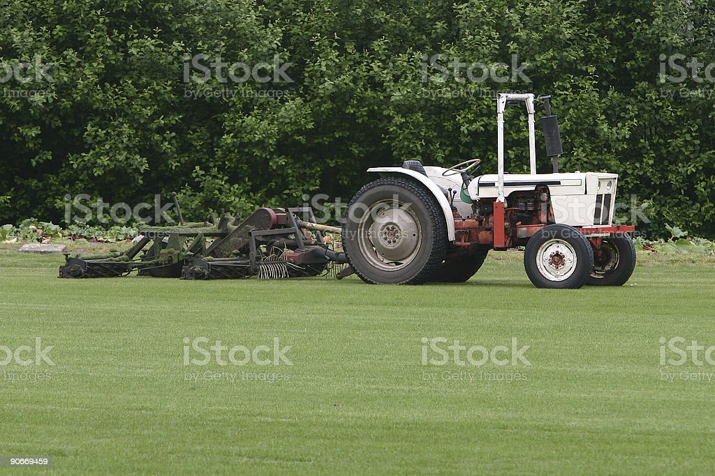 Tractor with lawn mower royalty-free stock photo
