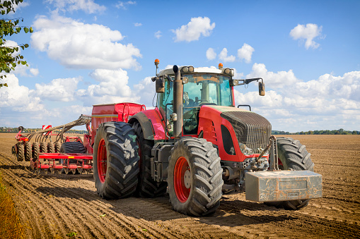Tractor with seeding and plowing machine on the plantation in Wielkopolska, Poland