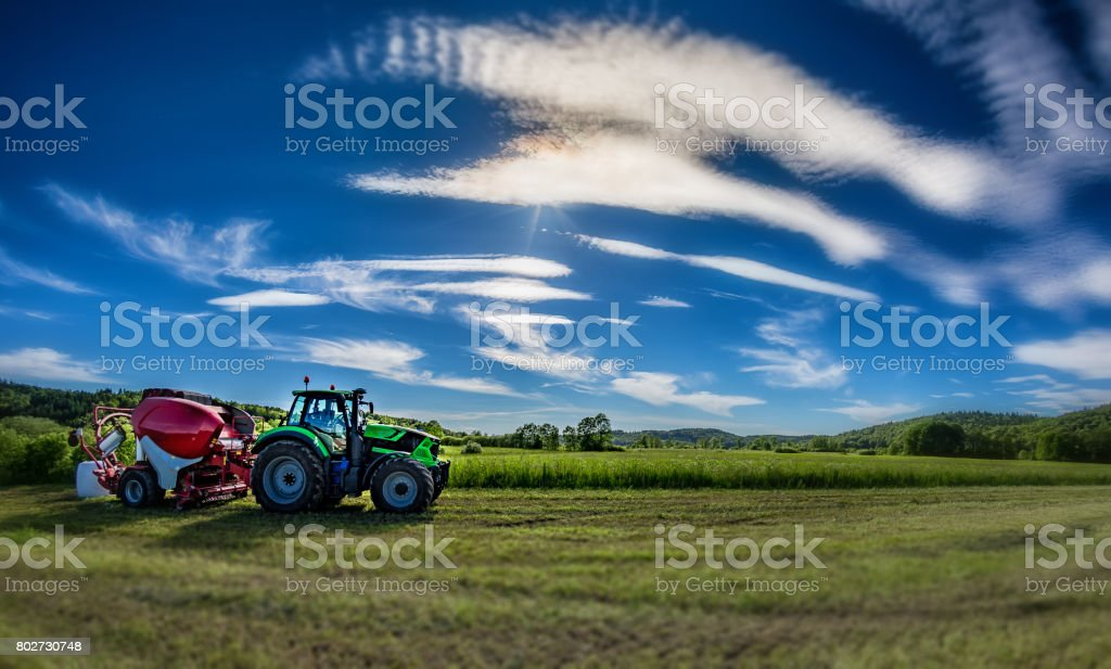 Tractor with silage bale machine stock photo