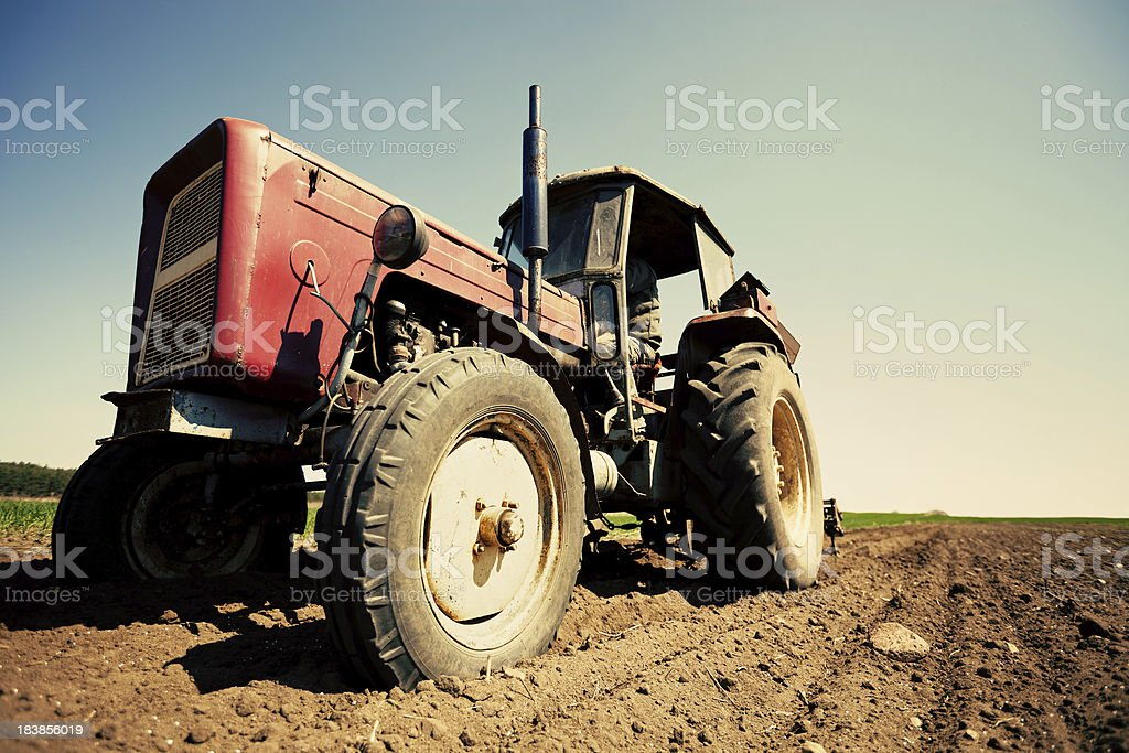 Tractor working in field royalty-free stock photo