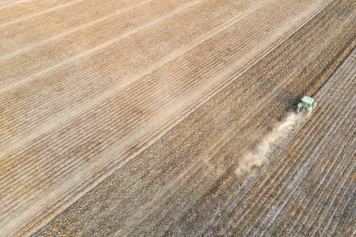 Tractor working on the cotton field. Antalya, Turkey, Taken via drone.