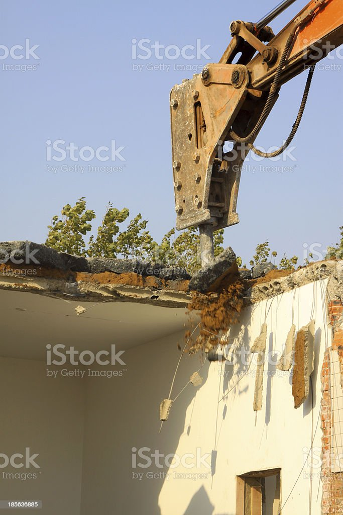 tractors are dismantling houses royalty-free stock photo