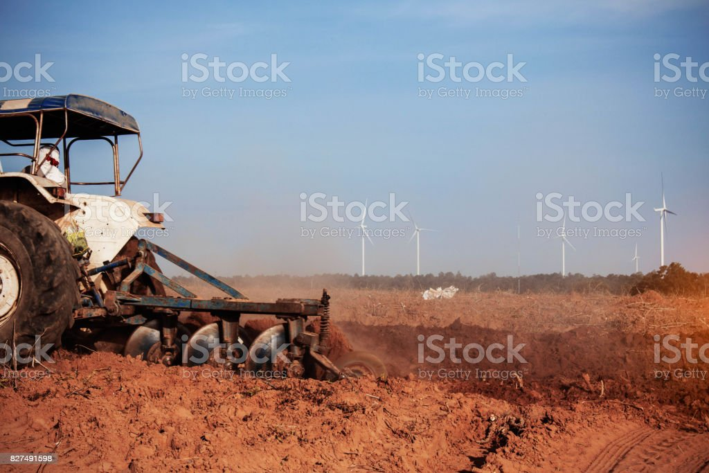 Tractors are plowing soil cultivation of cassava. stock photo